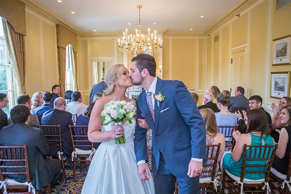 Bride and Groom Kissing in the Thayer Room - Hampshire House Boston